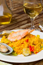 Dining with paella plate and glass of wine Royalty Free Stock Photos