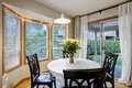 Dining room with curved window wall Royalty Free Stock Photo
