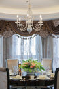 Dining room with luxury dinner set Stock Images