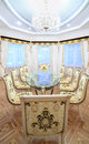 Dining room with luxury gilt furniture and beautiful table glass top in classic style Stock Image