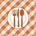 Dining room plate and cutlery on the background of the tablecloth abstract image Royalty Free Stock Photo