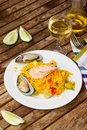 Dining with seafood paella plate and glass of wine Royalty Free Stock Photos
