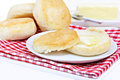 Dinner biscuits, one with melting butter. Royalty Free Stock Images