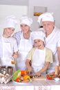 Dinner for the family grandparents with two boys are preparing Royalty Free Stock Photo