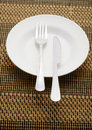 Dinner plate arrangement on mat background Royalty Free Stock Photography