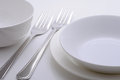 Dinner plates with two forks and bowl Royalty Free Stock Photography