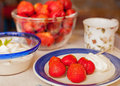 After dinner strawberry and cream with a cup of coffee Royalty Free Stock Photos