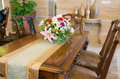 Dinning room a table with flower in a Royalty Free Stock Photo
