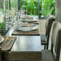 Dinning room with table setting on wooden table at home Royalty Free Stock Photo