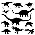 Dinosaur silhouettes collection against white background Royalty Free Stock Photos