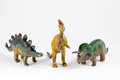 Dinosaurs plastic models dinosaur toys isolated over white background Stock Images