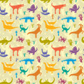 Dinosaurs seamless pattern with colorful on a background of ancient trees Stock Photos