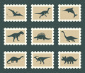 Dinosaurs set prehistoric animals on postage stamps Stock Photo