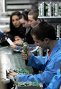 Diode factory workers assembling electronics in feb botevgrad bulgaria Stock Photo