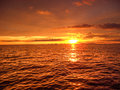 The dip of the sun hides under horizon by painting a picture a natural orange color Royalty Free Stock Photography