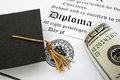Diploma and cash graduation cap money on a Stock Photography