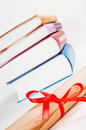 Diploma red ribbon books Stock Images