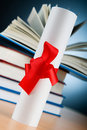 Diploma and stack of books Stock Images
