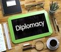 Diplomacy Handwritten on Small Chalkboard. 3D.