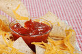 Dipping nachos in salsa Royalty Free Stock Photo