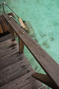 Direct access to crystal clear water from your private overwater bungalow via wooden and stainless steel stairs Stock Images
