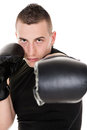 Direct punch portrait of young boxing man is giving a Royalty Free Stock Images