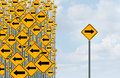 Direction individuality and independent thinking concept as a group of directional arrow traffic signs with one individual Stock Photo