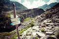 Direction sign on mountain trail, High Tatras, Poland Royalty Free Stock Photo