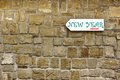 Direction signboard on the old stone wall with text new year street background and texture for text or image Royalty Free Stock Photo