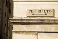 Directions to rialto bridge directional sign famous on old venetian building Royalty Free Stock Photo