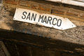 Directions to san marco square directional sign on old venetian building Royalty Free Stock Photos