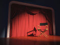 Director chair s on the stage illuminated by floodlights Royalty Free Stock Photo