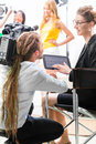Director giving cameraman direction for video production shoot or scene on set of a tv television or news Stock Photography