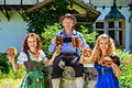 Dirndl beer pretzel oktoberfest group of men and women in traditional german tracht with and Stock Photos