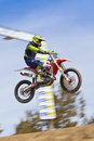 Dirt bike racer jumping sierra motor cross race in stead nevada march th th and th high desert spring series Royalty Free Stock Photography