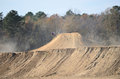Dirt Bike Riding on Side of Large Hill Stock Photos