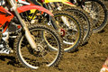 Dirt bike wheels motocross competition view of a few with special mud tires ready for start Royalty Free Stock Images