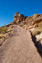 Dirt path way up to hill Royalty Free Stock Photo