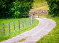 Dirt road curve at a Stock Photography