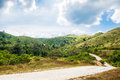 Dirt road curve peak mountain Royalty Free Stock Photo