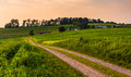 Dirt road and farm fields in rural Southern York County, Pennsyl Royalty Free Stock Photo
