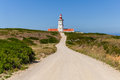 The dirt road leading to the espichel cape lighthouse built during th century is one of oldest lighthouses in portugal and Stock Images