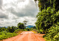 Dirt road in liberia west africa sodden after the rain the through the jungle Royalty Free Stock Photo