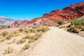Dirt road and red desert hills in bolivia leading through a with stunning rock the background near tupiza Royalty Free Stock Images