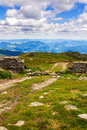Dirt road and ruin of stone wall on the top of pip ivan mountain in carpathians nature landscape ukraine Royalty Free Stock Photos