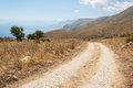 Dirt track in the Mediterranean countryside with mountains, sea Royalty Free Stock Photo