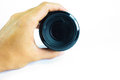 Dirty camera lens mm in hand on a white background Royalty Free Stock Photo