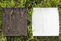 Dirty and clean vehicle air filters on the green grass Stock Photos