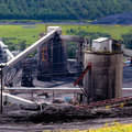 Dirty coal mine structures fossil energy resource Royalty Free Stock Photo