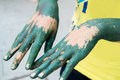 Dirty, colored hands with green paint Royalty Free Stock Photo